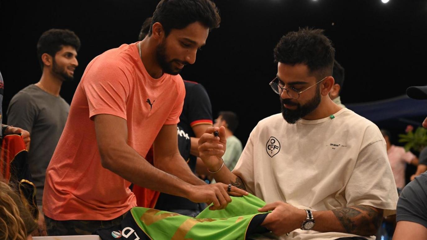 Mohammed Azharuddeen took to social media to post a picture of Virat Kohli autographing a jersey for him.